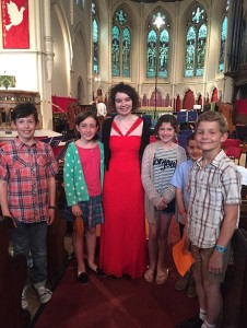 Soloist Lucy Arch (Cello) and some of the FRONT10 children
